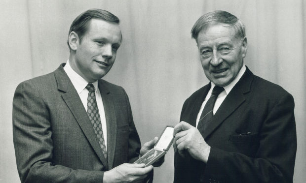 First man on the moon Neil Armstrong receives a Livingstone Medal from Lord Balerno of the Royal Scottish Geographical Society.