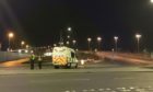 Police officers stopping traffic in Dundee