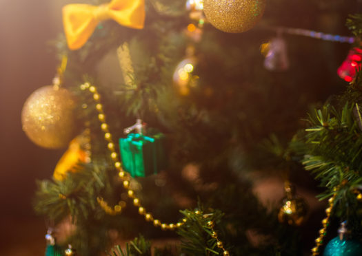 A Christmas tree was chopped down during the incident. Stock image.