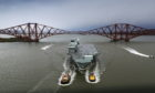 HMS Queen Elizabeth has sailed under the Forth bridges once more, as she returns to her birth place for a scheduled period of maintenance.
