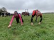 Gayle and Alasdair Chisholm take on the 10-metre tractor pulling challenge at Farming Fit!