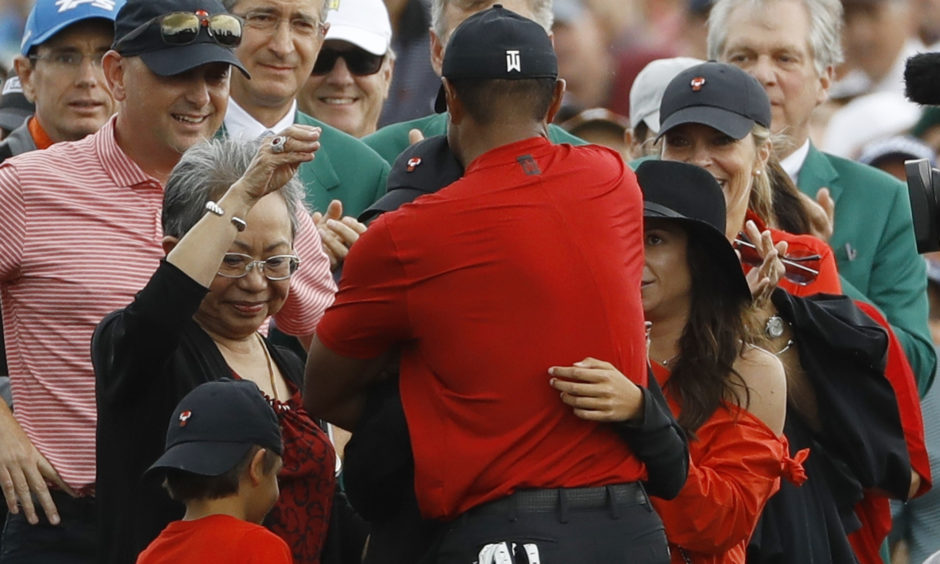 Tiger Woods hugs his family after winning the Masters.