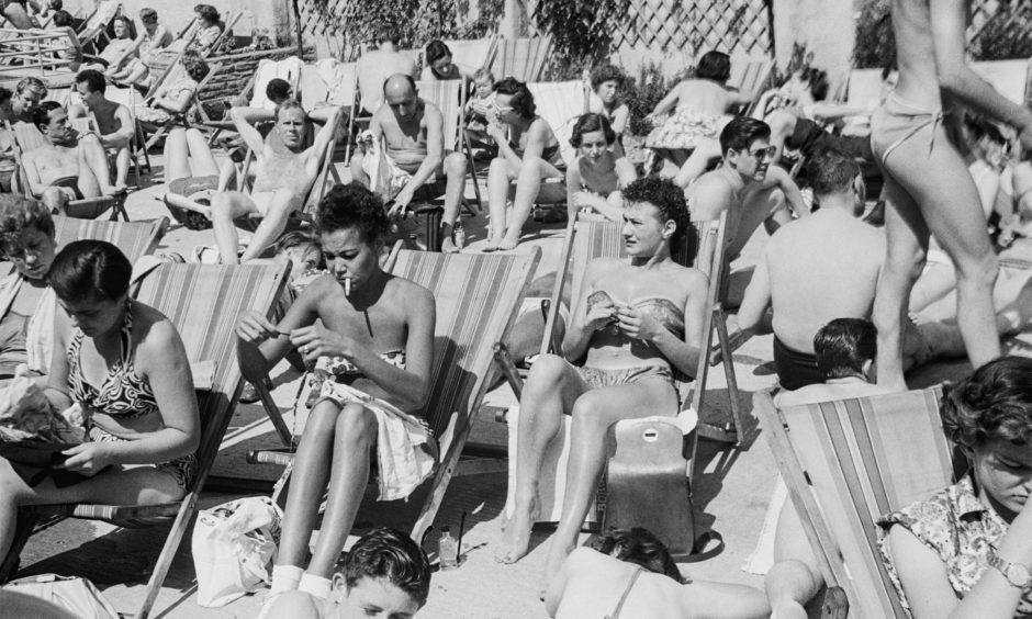 Londoners enjoying the heat wave at a rooftop pool in Holborn, London, UK, Summer 1952. Original Publication: Picture Post - 6196