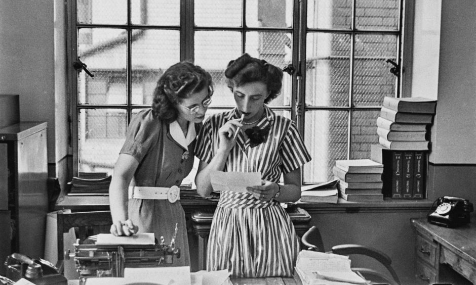 Two female reporters in their office, UK, March 1952. Original Publication: Picture Post