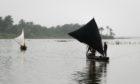 Fishermen on a river in the Niger Delta region, Nigeria.