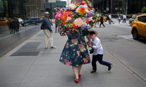 Laura Bopp wears a homemade flower hat while walking with her son Henry King, 7, in Midtown after the annual Easter Parade.
