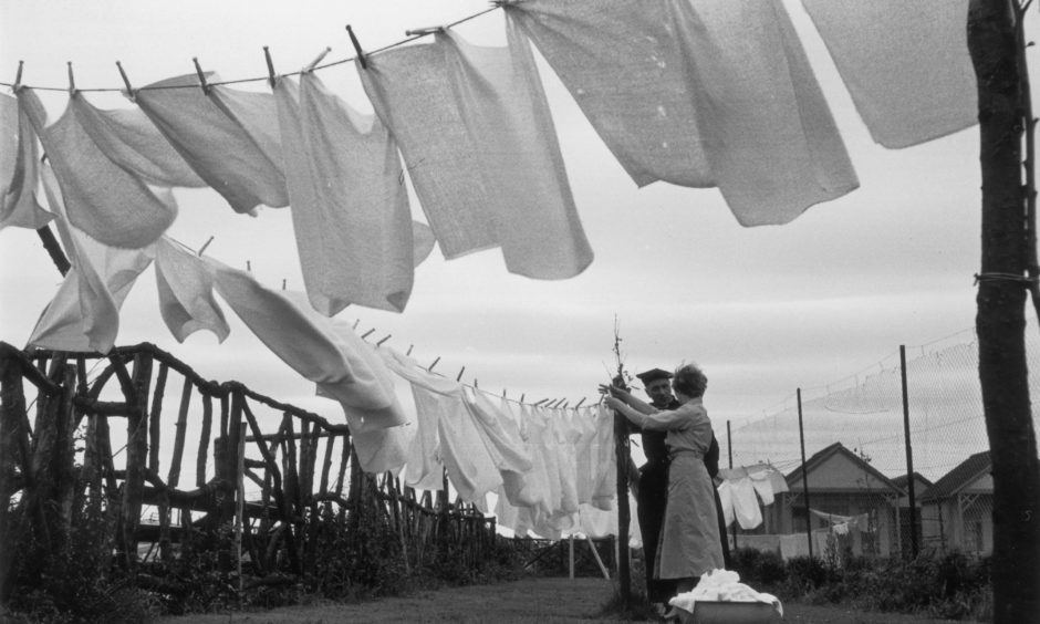 1st July 1955:  Washing lines blowing in the wind at Butlin's Holiday camp at Skegness in Lincolnshire. The camp provides a free nappy washing service.  Original Publication: Picture Post