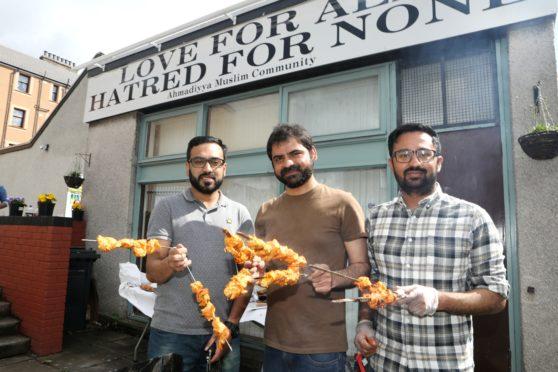 Adeel Ahmad Malih , Fawad Baloch and Adnan Shahzad prepare the food.