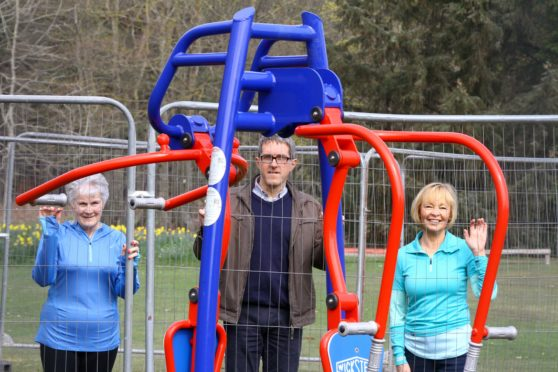 Eileen Haggart, Dr Marc Jacobs and Janet Fowlie of the Edzell Village Improvement Society beside the new gym equipment.