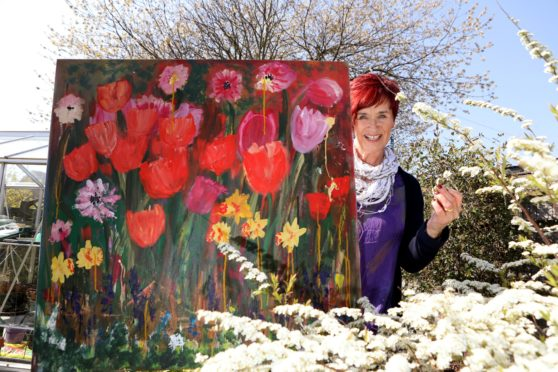 Trish Winton with one of her paintings