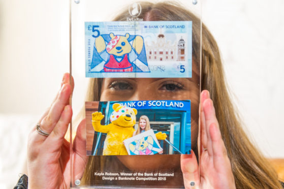 Kayla Robson with her Pudsey banknote.