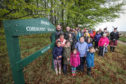 Members of the Dronley Community Woodland celebrating the purchase of Dronley Woods.
