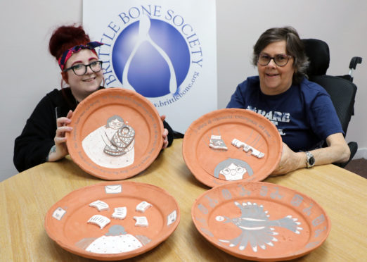(L-r) Nicole McLaughlin and Yvonne Grant with the clay plates