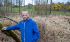 Jason David stands at the spot where a dog mauled a deer to death in Lochore.