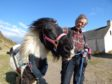 Obama the pony with Simon Mulholland at St Cyrus Nature reserve.