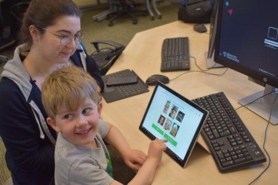 Ethical Hacking student Michaela Stewart and Matthew Prior, four, use Kidzpass