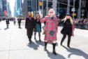 Sir Billy Connolly leading the New York City Tartan Day Parade as Grand Marshal on Saturday in front of around 30,000 spectators, accompanied by family including his wife Pamela (right).