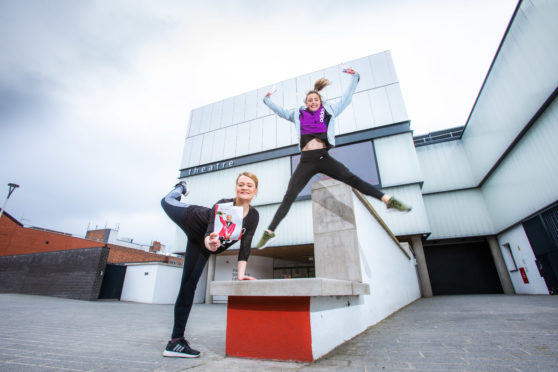 Dancers Danielle Tyrer and Siobhan Marshall unveil the new season brochure at Perth Theatre.