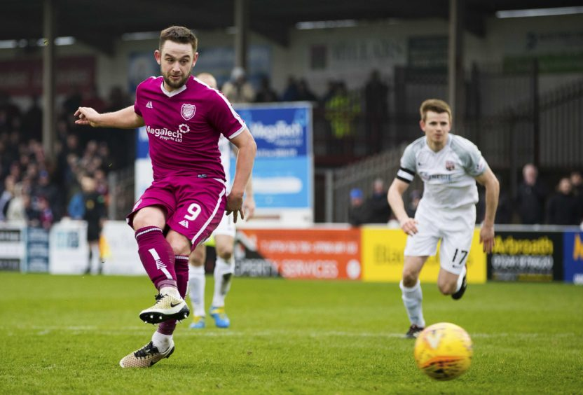 Arbroath's Ryan Wallace sees his late penalty saved.
