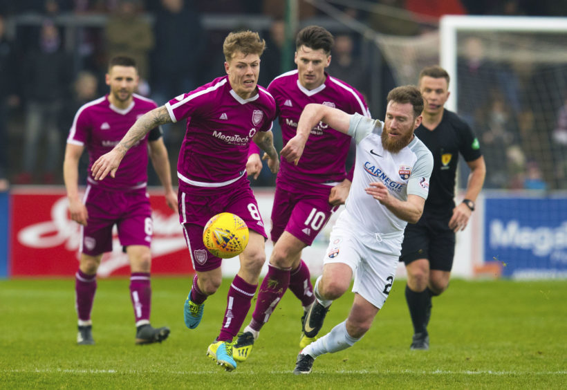 Montrose's Patrick Cregg (R) in action with Arbroath's David Gold.