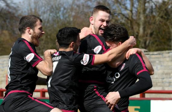 Arbroath striker Ryan Wallace celebrates his goal to make it 1-0.