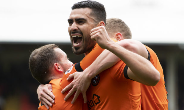 Rachid Bouhenna celebrates his goal.
