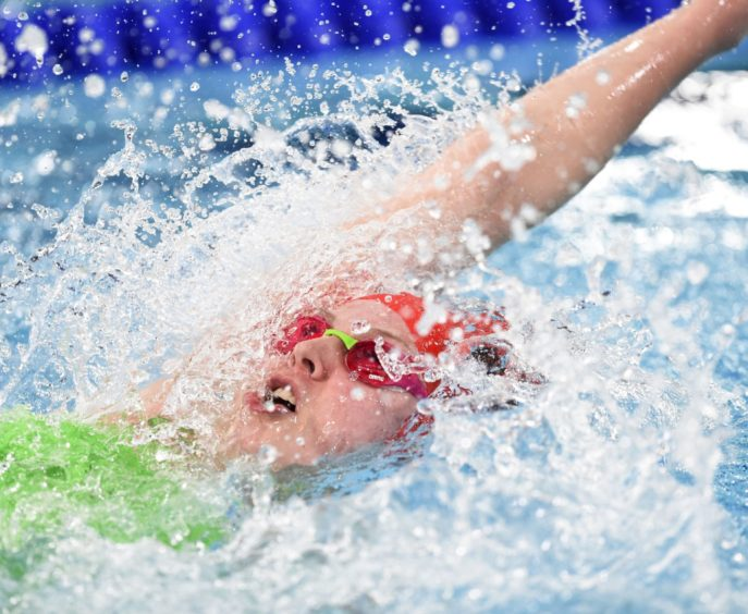 Issey-May Reeves competing in her heat of the womens 100m Backstroke.