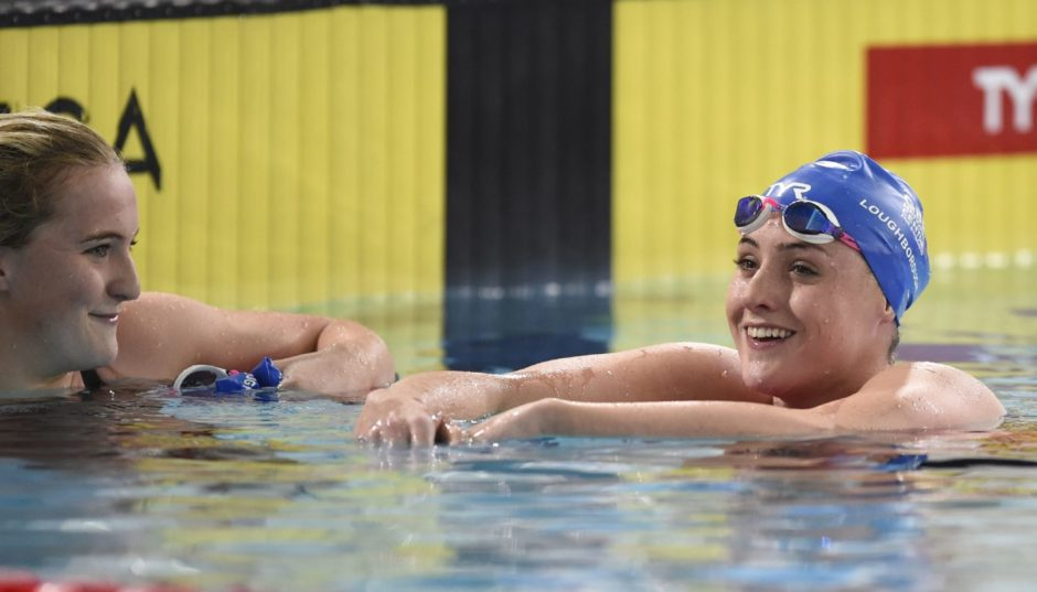Abbie Wood looks on after Molly Renshaw (right) won Heat 7 of the Women's 200m Breaststroke.