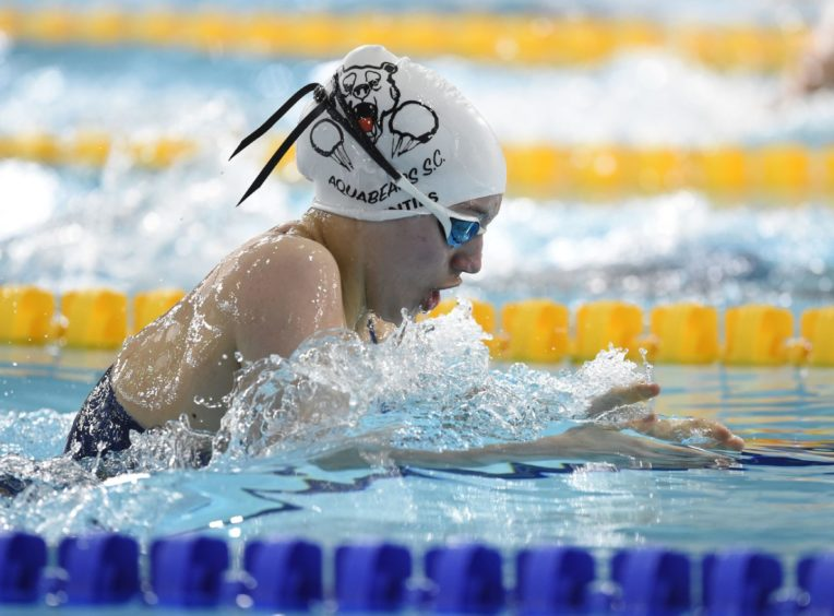 Lucy Cannavan competing in Heat 2 of the Women's 200m Breaststroke.