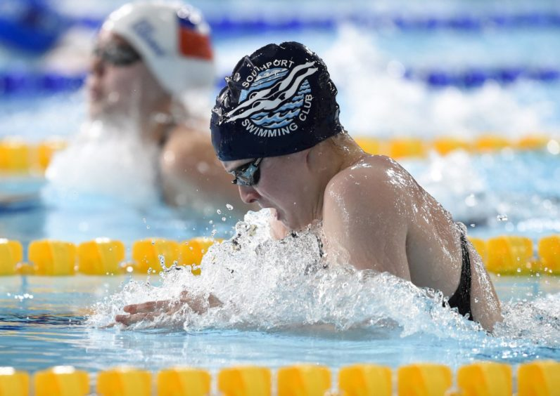 Victoria Dawson competing in Heat 2 of the Women's 200m Breaststroke.