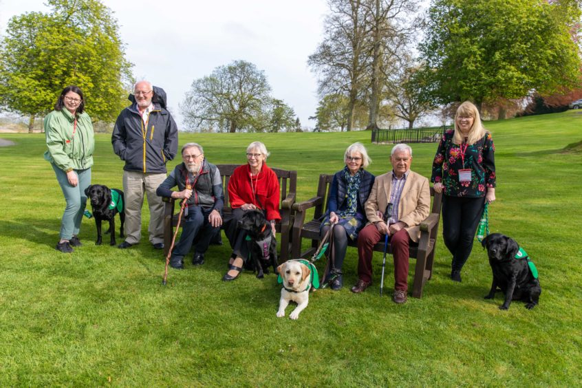 Families hail life-changing impact of Tayside dementia dogs as eight animals celebrate 'graduation'
