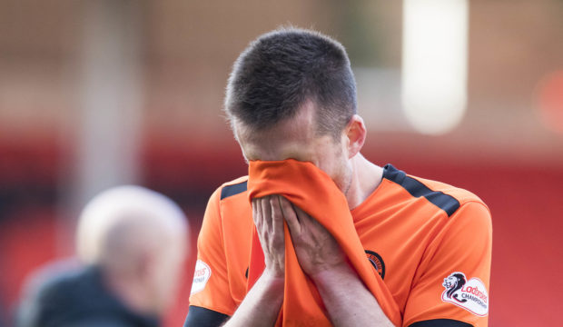 A dejected Callum Booth at full-time.