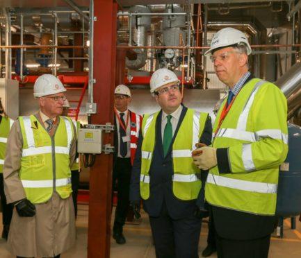 Paul Wheelhouse (centre) with Ross Vettraino (left) hears from Ian Clavert, of RWE, how the energy centre works
