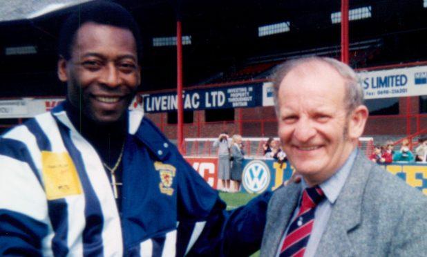 Football stalwart George Hill met footballing legend Pele at Dens Park.