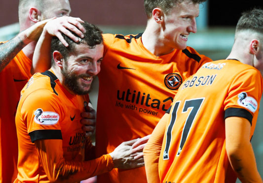 The Dundee United players celebrate Paul McMullan's weekend winner.