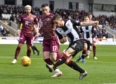 St Mirren's Mateo Muzek and Michael O'Halloran in action.