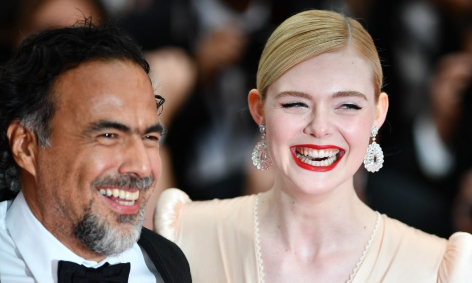 Jury President Mexican director Alejandro Gonzalez Inarritu (L) and Jury member US actress Elle Fanning (R) arrive for the screening of the film 'The Dead Don't Die' and the Opening Ceremony.