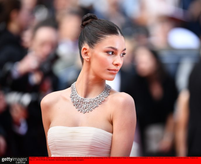 US model and actress Camila Morrone arrives for the screening of the film 'Once Upon A Time... In Hollywood' in competition at the 72nd annual Cannes Film Festival in Cannes, France.