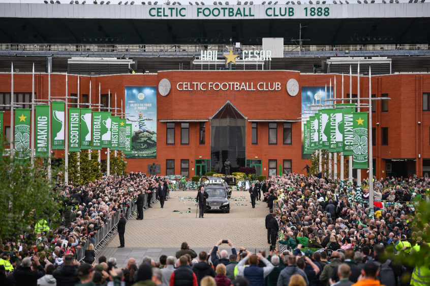 The funeral cortege of former Celtic player and manager Billy McNeill, makes its way down Celtic Way past his statue on May 3, 2019 in Glasgow, Scotland. The funeral of the first Briton to lift the European Cup in Lisbon in 1967, was held today at St Aloysius Church in Glasgow
