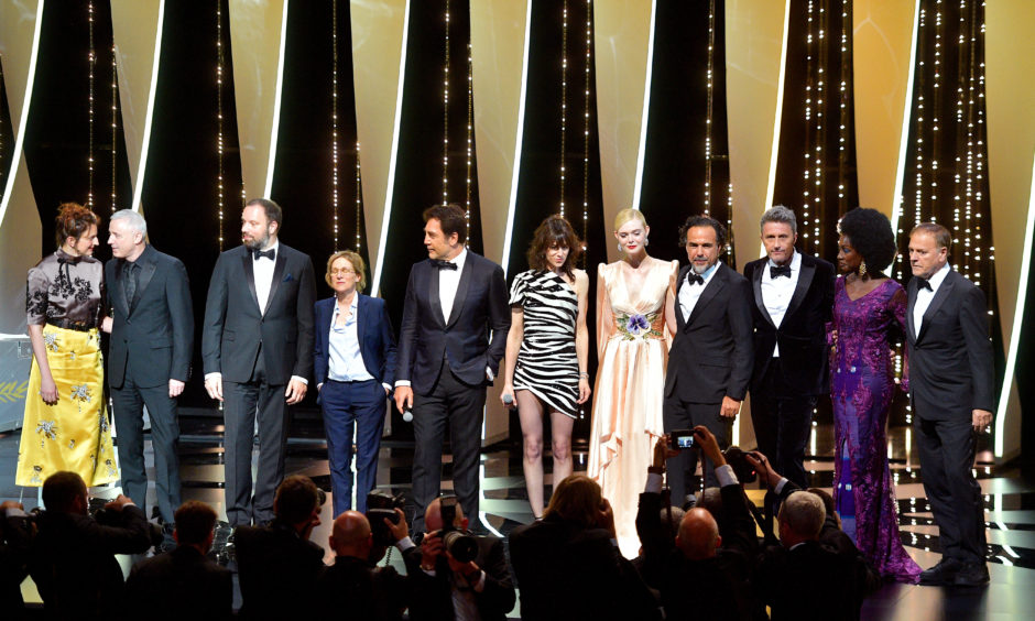 Jury Members Alice Rohrwacher, Robin Campillo, Yorgos Lanthimos, Kelly Reichardt, Javier Bardem, Charlotte Gainsbourg, Jury Member Elle Fanning, wearing Chopard jewels, President of the Main competition jury Alejandro Gonzalez Inarritu, Jury Members Pawel Pawlikowski, Maimouna N'Diaye and Enki Bilal (l-r) attend the Opening Ceremony during the 72nd annual Cannes Film Festival on May 14, 2019 in Cannes, France.