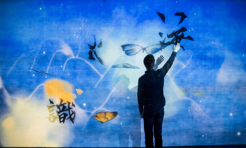 'What a Loving and Beautiful World' by teamLab is displayed as part of the 'AI: More than Human' exhibition.