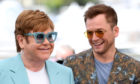 Taron Egerton and Sir Elton John share a joke.
