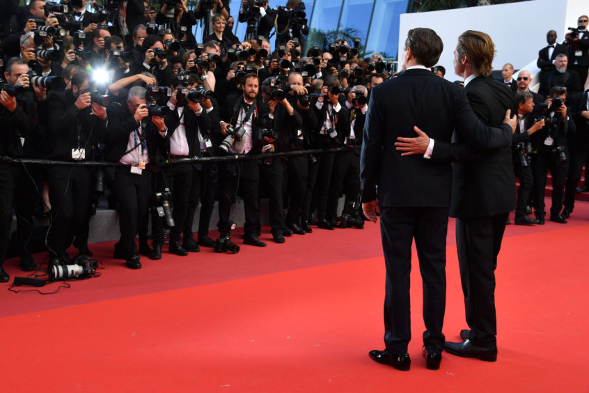 """Leonardo DiCaprio and Brad Pitt attend the screening of """"Once Upon A Time In Hollywood"""" during the 72nd annual Cannes Film Festival on May 21, 2019 in Cannes, France."""