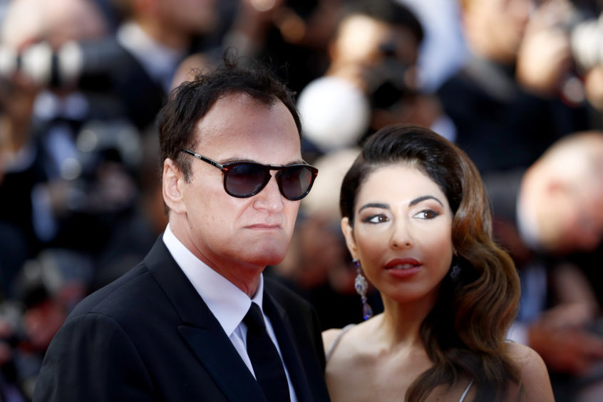 """Quentin Tarantino and Daniela Pick attend the screening of """"Once Upon A Time In Hollywood"""" during the 72nd annual Cannes Film Festival on May 21, 2019 in Cannes, France."""