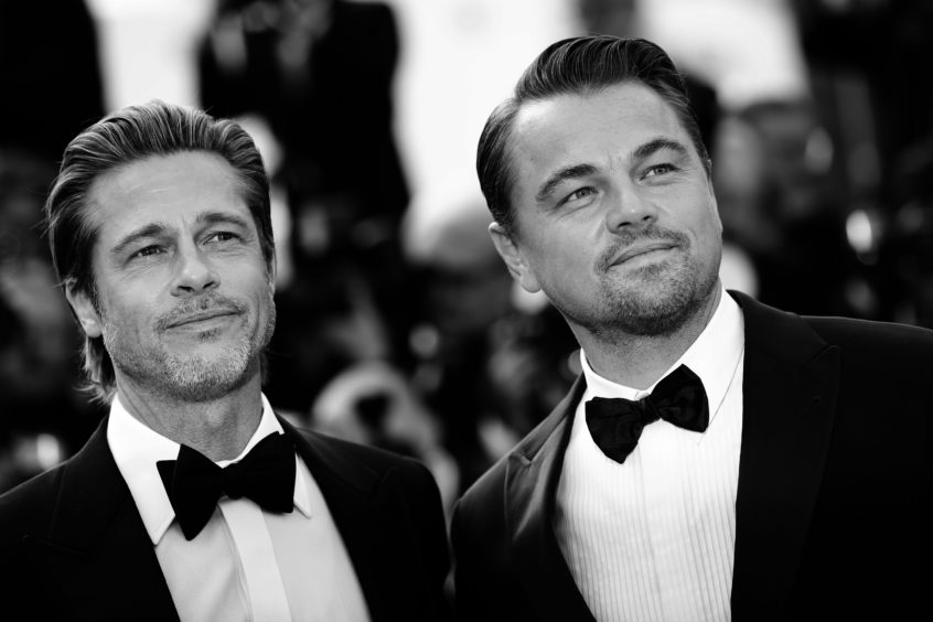 """Brad Pitt and Leonardo DiCaprio attend the screening of """"Once Upon A Time In Hollywood"""" during the 72nd annual Cannes Film Festival on May 20, 2019 in Cannes, France."""