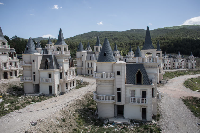 Hundreds of castle-like villas and houses are seen unfinished at the Burj Al Babas housing development . Construction on the luxury housing project began in 2014 and aimed to build 732 villas, a shopping mall and entertainment facilities targeted at foreign buyers. However the future of the villas is now uncertain after the developers, Sarot Property Group filed for bankruptcy after buyers and investors pulled out of the 150million euro project. The economic downturn and weakening Turkish lira have left many companies unable to pay large foreign currency debts borrowed to finance projects, resulting in many companies filing for bankruptcy and leaving projects unfinished.