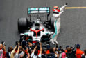 Race winner Lewis Hamilton of Great Britain and Mercedes GP celebrates in parc ferme during the F1 Grand Prix of Monaco at Circuit de Monaco.