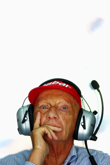 (FILE PHOTO)  F1 Legend Niki Lauda Dies At 70 announced on May 21, 2019 KUALA LUMPUR, MALAYSIA - MARCH 22:  Former Formula 1 driver and non-executive chairman of Mercedes, Niki Lauda watches the timing screens during practice for the Malaysian Formula One Grand Prix at the Sepang Circuit on March 22, 2013 in Kuala Lumpur, Malaysia.  (Photo by Paul Gilham/Getty Images)