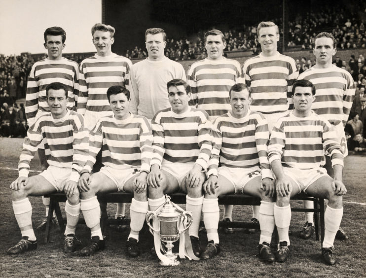 FILE: Celtic legend Stevie Chalmers Dies aged 83 Celtic football team, winners of the Scottish FA Cup, at Celtic Park in Glasgow, circa April 1965.  They defeated Dunfermline Athletic by a score of 3-2. Back row, left to right:  Ian Young, Tommy Gemmell, John Fallon, Bobby Murdoch, Billy McNeill and John Clark; front row, left to right:  Stevie Chalmers, Charlie Gallagher, Yogi Hughes, Bobby Lennox and Bertie Auld.