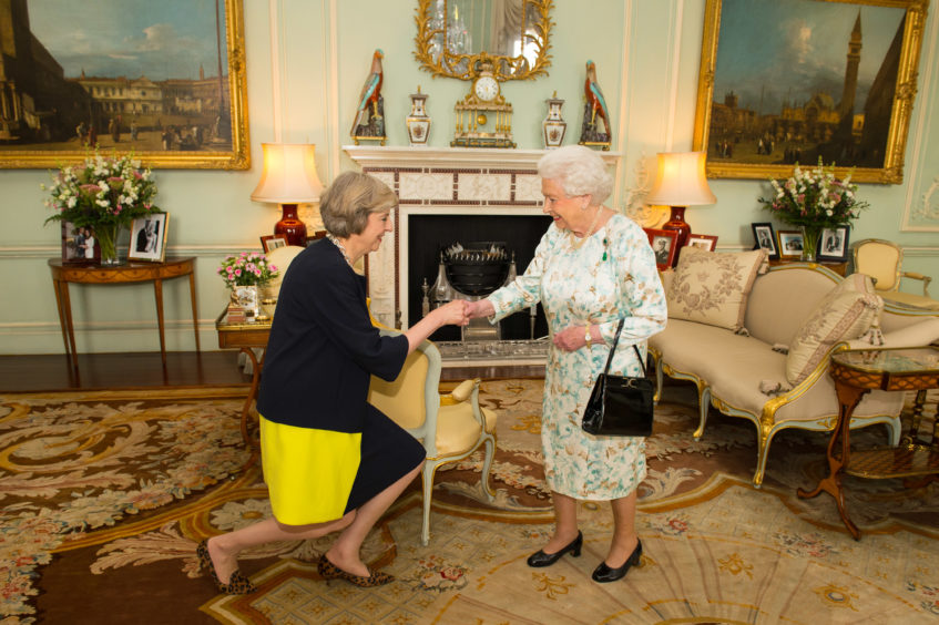 Queen Elizabeth II welcomes Theresa May at the start of an audience where she invited the former Home Secretary to become Prime Minister and form a new government at  Buckingham Palace on July 13, 2016 in London, England. Former Home Secretary Theresa May becomes the UK's second female Prime Minister after she was selected unopposed by Conservative MPs to be their new party leader. She is currently MP for Maidenhead.